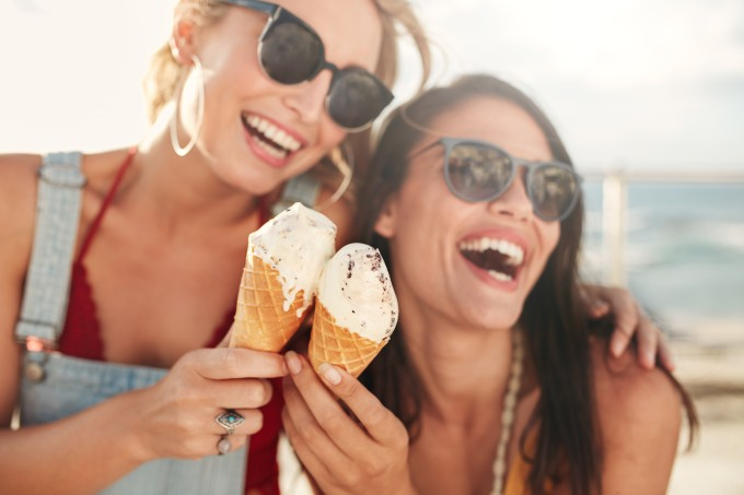 Female friends having fun and eating ice cream