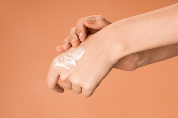 person-applying-hand-cream-3762875