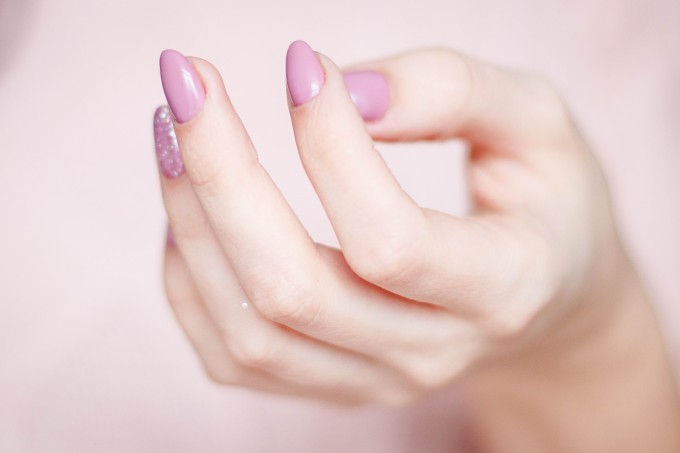 person-s-hand-with-pink-manicure-939835
