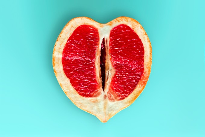 heart shaped ripe juicy grapefruit  isolated on a blue background