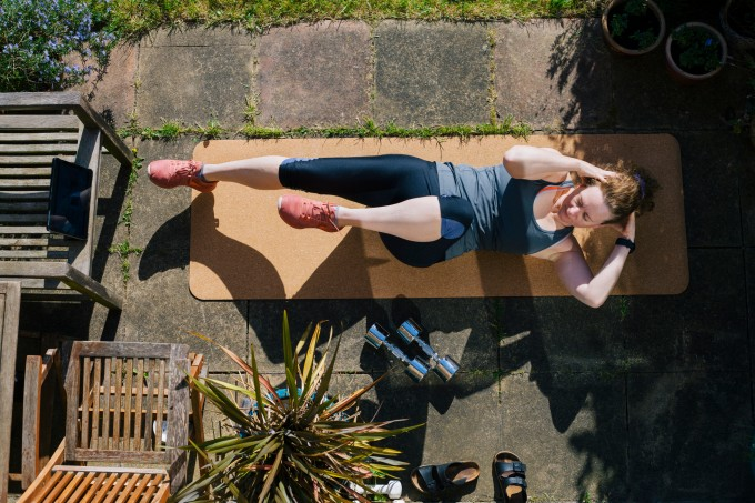 Woman exercising in her garden
