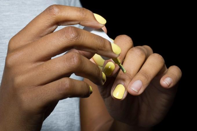 Close-up of application of nail varnih