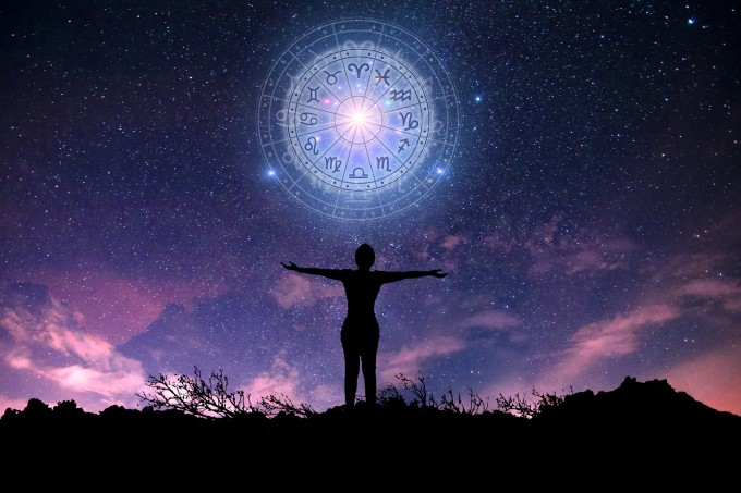 Zodiac signs inside of horoscope circle. Astrology in the sky with many stars and moons  astrology and horoscopes concept