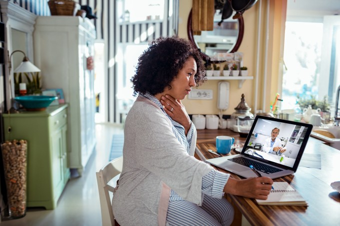Mature woman consulting with her doctor online