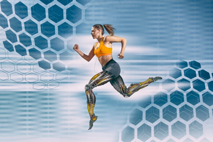 Beautiful female athlete with artificial robotic legs running fast