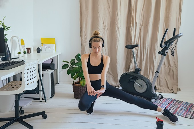 young adult woman exercising at home, stay at home covid-19 quarantine gym, healthy lifestyle, bodyweight exercises