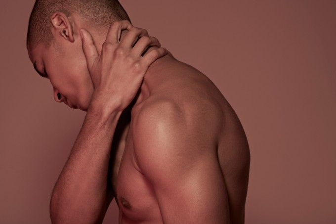 Young man having neck pain