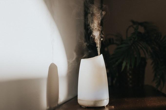 A white Oil Diffuser / Humidifier in a Domestic Setting