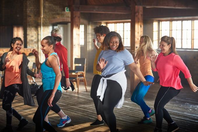 Women dancing in gym.
